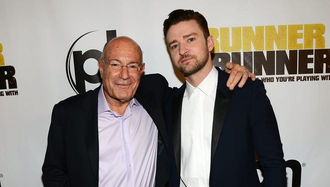 "Regency Chairman Arnon Milchan, left, and singer/actor Justin Timberlake arrive at the world premiere of Twentieth Century Fox and New Regency's film ""Runner Runner"" at Planet Hollywood  in Las Vegas on Sept. 18."