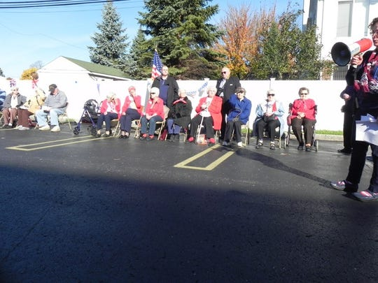 World War II veterans and Rosie the Riveters are honored before runners and walkers answer the starting gun at the Rosedale Red, White and Blue 5K and 1 Mile.