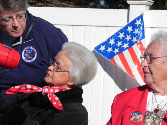 Beth Fordyce (left), worked as a Rosie the Riveter during World War II. She grew up on a farm and still farms with her daughter. Mother and daughter live in a farmhouse they recently built. Fellow Rosie Loraine Osborne (right), looks on as Fordyce is introduced at the veterans' event.