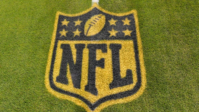 A general view of an NFL logo on the 50-yard line prior to an NFL football game between the Cleveland Browns and the Baltimore Ravens Monday, Nov. 30, 2015, in Cleveland.