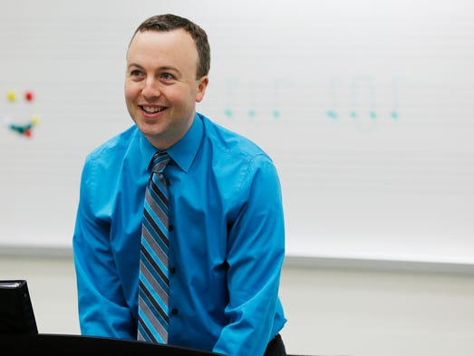 Vocal music teacher Michael Bennett leads his students Thursday, April 10, 2014, at Jefferson High School. Bennett has been awarded a 2014 Golden Apple for teaching excellence.