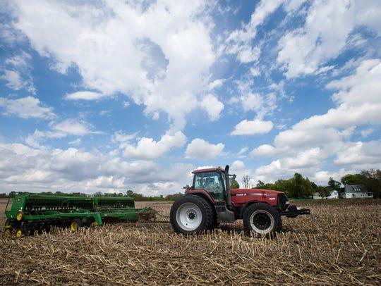 Farmer Tim Bardole plants a field near Perry Tuesday,