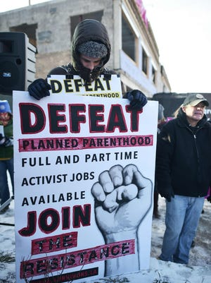 An anti-abortion activist holds a placard during a protest outside of a Planned Parenthood center construction site on Jan. 21, 2016 in Washington, DC. The protest comes a day ahead of the annual March for Life.  Mandel NganMANDEL NGAN/AFP/Getty Images ORIG FILE ID: 548090068