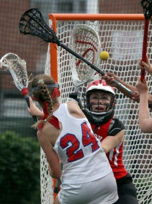 Red Hook goalie Gardner DeCourcey Gardner makes a save on a shot by Goshen's Rilkey Miller during the Section 9 Class C girls lacrosse championship at the Newburgh Free Academy May 23, 2017.