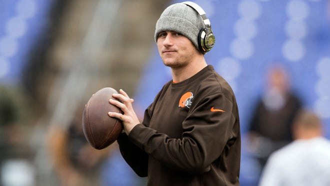 In a file photo from Dec. 28, 2014, Browns quarterback Johnny Manziel warms up prior to the game against the Baltimore Ravens at M&T Bank Stadium.