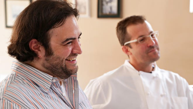 Republic restaurant critic, Dominic Armato, and Scott Holmes of Little Miss BBQ share a laugh at citizen's Public House while discussing the upcoming dinner sevenValley chefs will be hosting at the James Beard House in NYC in November in Scottsdale on June 9, 2015.