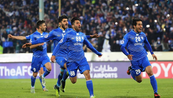 Esteghlal players celebrate after winning the 2017 AFC Champions League Play-off soccer match between Esteghlal FC and Al Sadd SC at the Azadi Stadium in Tehran, Iran, Feb. 7, 2017.