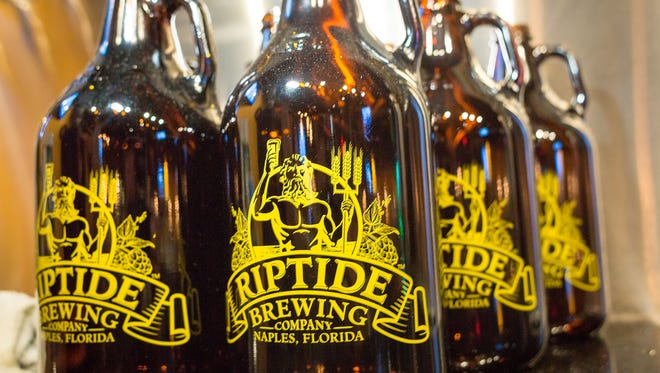 Empty growlers await beer for customers at the Riptide Brewing Company in Naples.
