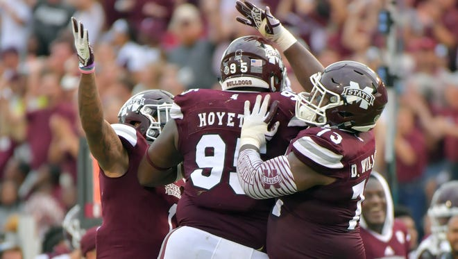 Mississippi State defensive lineman Braxton Hoyett (95) reacts after recovering a Kentucky fumble during the second half at Davis Wade Stadium.