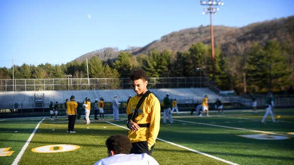 Reynolds sophomore Seth Eberhardt talks with a teammate on the sidelines during practice at the school on Wednesday, Nov. 29, 2017. Eberhardt is out for the season after an injury.