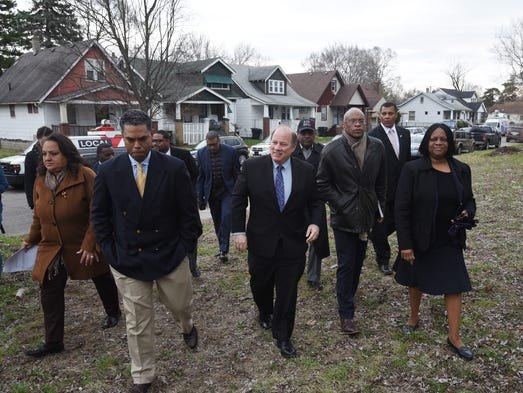 Detroit Mayor Mike and others involved arrive for a