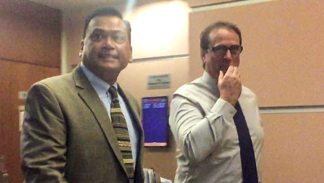 "University of Guam Professor Michael Blair Ehlert, 55, right, is seen in an image taken from video, as he walks with his attorney, Joaquin ""Jay"" Arriola Jr., at the Superior Court of Guam in Hagåtña on Thursday, March 2, 2017. Ehlert appeared for a court hearing before Judge Vernon Perez. He now faces a new charge of third-degree criminal sexual conduct as a second-degree felony. Ehlert faced previous filed charges of two counts of third-degree criminal sexual after being accused of touching the private parts of two women in an Oct. 2014 incident."