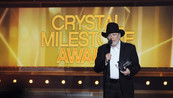 Merle Haggard accepts the Crystal Milestone Award during the 49th annual ACM Awards at the MGM Grand Garden Arena in Las Vegas on April 6, 2014.