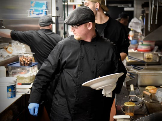 Head chef Justin Berhow works the line during lunch
