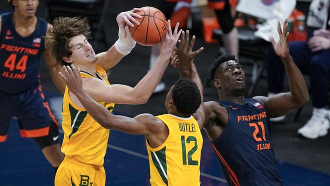 Baylor's Matthew Mayer (24) takes the rebound away from Illinois' Kofi Cockburn (21) as Jared Butler (12) watches during the second half of an NCAA college basketball game, Wednesday, Dec. 2, 2020, in Indianapolis.