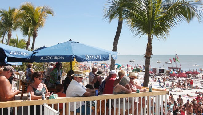 Visitors to Fort Myers Beach dine on the deck at the Lani Kai on Sunday afternoon.