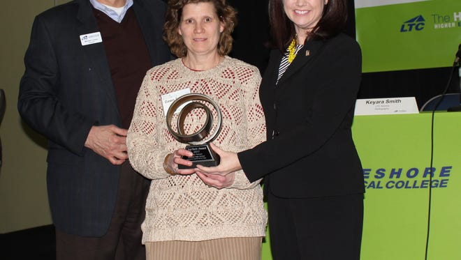 2017 TopTech Award recipient Dawn Tennant, Mishicot High School (center) poses with her award and LTC President Mike Lanser (left) and Wisconsin Lt. Gov. Rebecca Kleefisch (right).