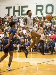 New Haven's Romeo Weems (1) jumps to shoot the ball