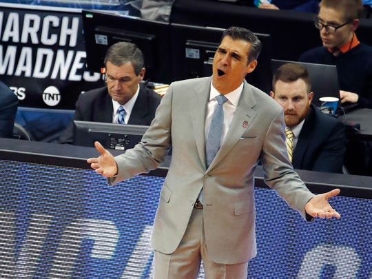 Villanova head coach Jay Wright questions a call during the first half of an NCAA men's college basketball tournament first-round game against Radford, in Pittsburgh, Thursday, March 15, 2018. (AP Photo/Gene J. Puskar)