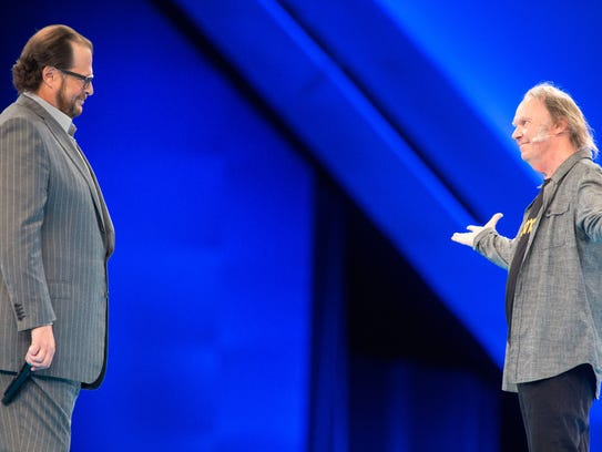 Marc Benioff, left, welcomes his friend musician Neil