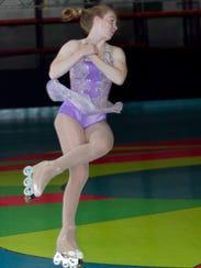 Kaylee Brogan performs a jump in a recent practice