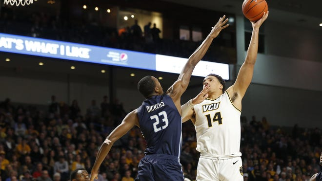 VCU forward Marcus Santos-Silva, who is from Taunton, Mass., takes a shot over Old Dominion's Dajour Dickens during a game last December.