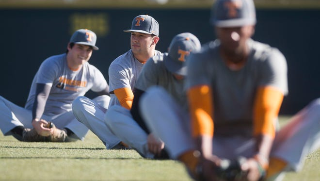 Tennessee baseball players stretch.
