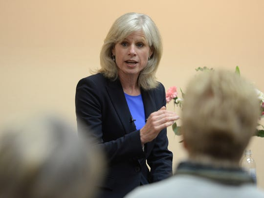 Democratic gubernatorial candidate Mary Burke talks about her campaign platform during a women's luncheon Friday at the Brown County Central Library.