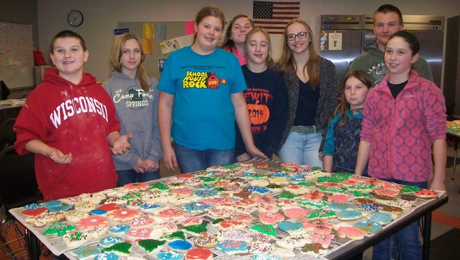 Rozellville Rockets 4-H Club members made and decorated cookies for a fundraiser Dec. 1 and 2 at Hub City Ice Cream in Marshfield.