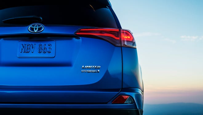 Toyota is dropping at hints of the look of the electric RAV4 it will introduce at the New York Auto Show