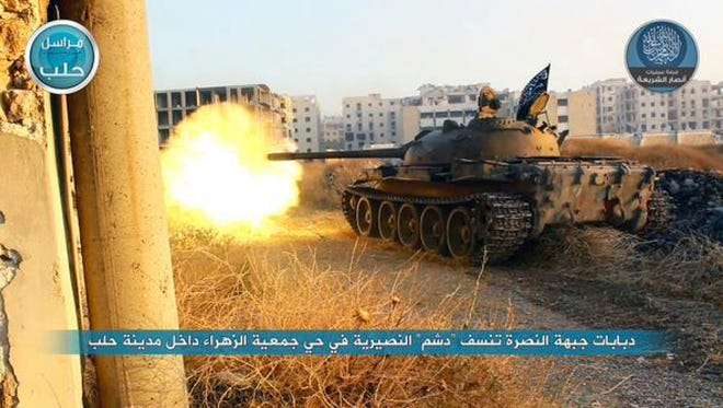 An al Nusra tank fires on Syrian forces.