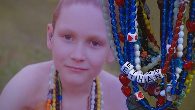 Ethan Hallmark's beads represented a dose of treatment, trip to the hospital, or memorable step in Ethan's cancer battle. Ethan died in September 2014.