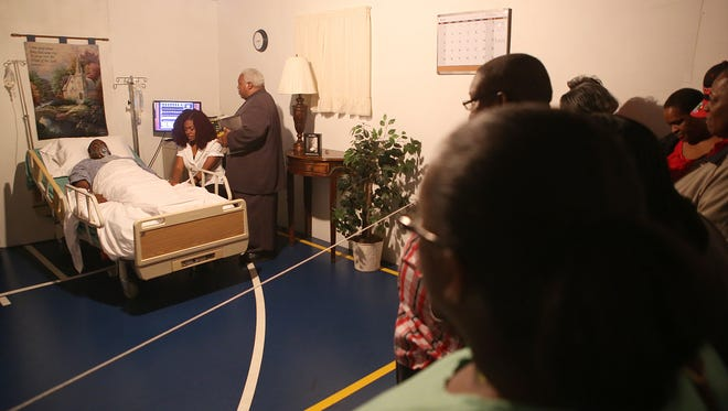 The Judgement House tour views a hospital scene at Bethlehem #1 Missionary Baptist Church in Medon on Wednesday night.