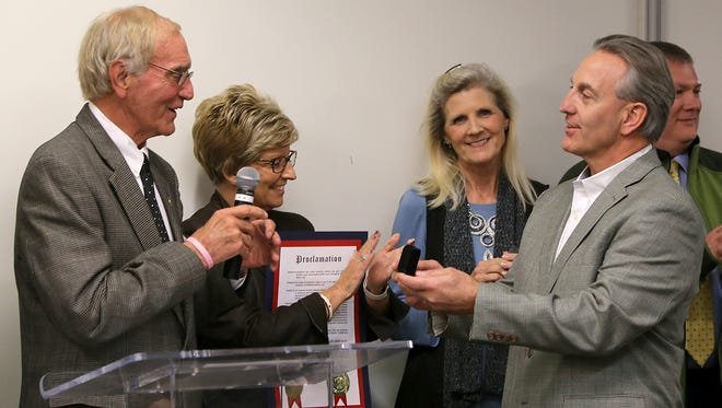 Mayor Jerry Gist, left, presents South Elementary School principal Scott Nelson with a set of cufflinks during the Alliance for a Healthier Generation recognition ceremony at the LIFT Wellness Center, on Monday, Nov. 16, 2015. South, along with Beech Bluff Elementary School, were the only schools in Tennessee to receive the gold award.