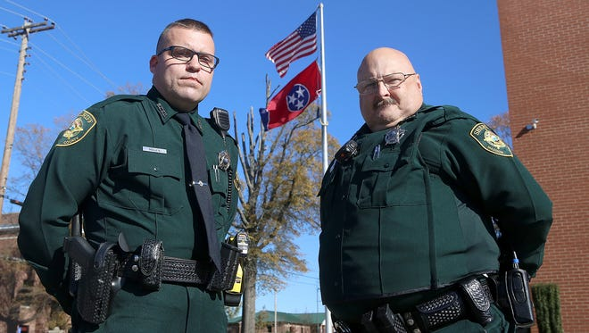 Madison County Sheriff's Office Deputies Barry Mosier, left, and Randall Blankenship model the new uniforms at the Sheriff's Office on Monday.