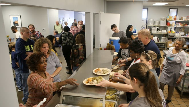 Regional Inter-Faith Association volunteers plate Thanksgiving lunch at the RIFA Soup Kitchen on Thursday.