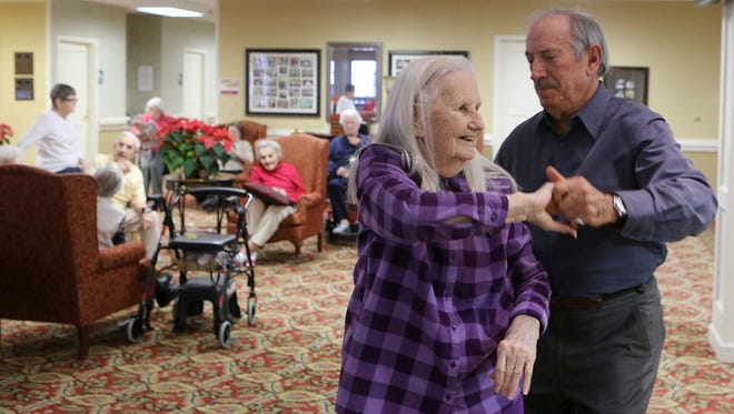 Buddy Glassman, right, dances with Willie Larson at the Regency Retirement Village on Thursday afternoon.