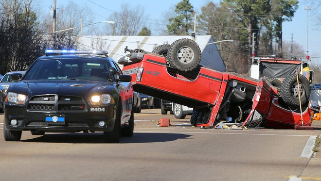 A pickup truck overturned at North Highland Avenue and Vann Drive on Tuesday, Jan. 5, 2016. Police said a pickup truck was traveling down the Interstate 40 ramp too fast, and the truck rolled. The truck clipped one other car in the accident. No serious injuries have been reported, police said.