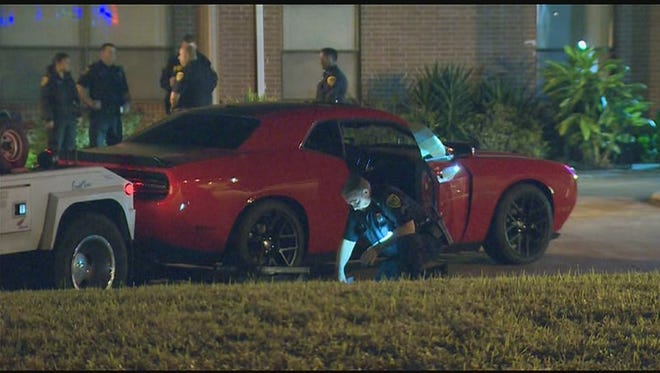 A car salesman in Houston was beaten up and thrown in the trunk of this red Dodge Challenger on Monday, Jan. 4, 2016. The salesman is safe.