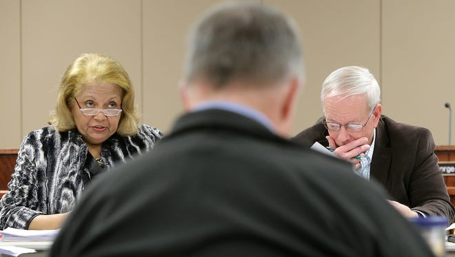Superintendent Dr. Verna Ruffin, left, talks about the implementation plan for Vision 2020, as Bob Alvey, center, and Jim Campbell follow along, during a school board work session at the Jackson-Madison County School System Central Office on Monday.