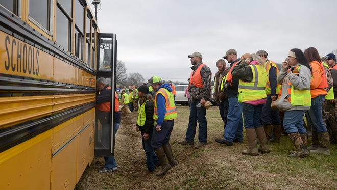 Arthur Priddy boards a school bus to head out to search for Noah Chamberlin at the old Pinson school on Friday.