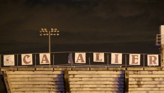 The damaged sign on Cavalier Stadium is seen after a storm Tuesday at Crockett County High School in Alamo.