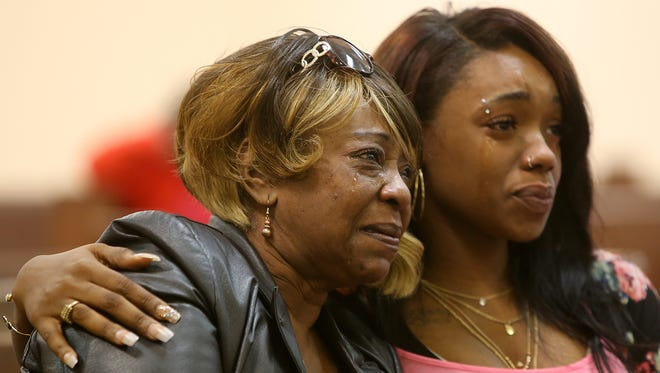 Rosa Rogers, left, is overcome with emotion during Corbyn Davis' preliminary hearing in Jackson City Court on Thursday. Davis is charged with first-degree murder of Rogers' son Jamar.
