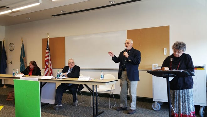 Milton mayoral candidate Ted Kanakos address a question during a candidate forum prior to Milton's 2016 election. To his left are current Mayor Marion Jones (left) and former mayor Cliff Newlands (center).