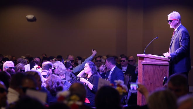 Jackson Chamber President and CEO Kyle Spurgeon gets the audience to put on complimentary sunglasses and take a picture during the Chamber's Annual Celebration on Thursday at Union University's Carl Grant Events Center.