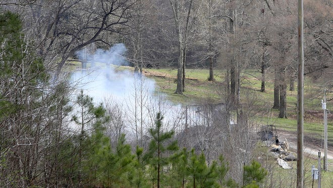 Smoke billows from the remains of a house on Antioch Road near Middleton on Wednesday. A woman died after the house caught fire early Wednesday in Hardeman County.
