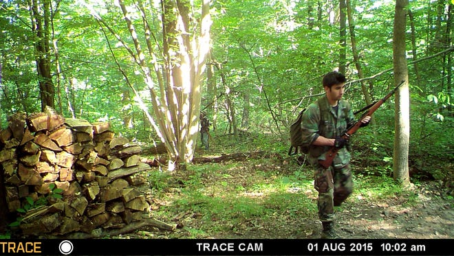 Joshua Malave of Cinnaminson, N.J. is seen wearing camouflage and running with a rifle he used to shoot at police before he was shot and killed after burglarizing Horseshoe Pike Gun Shop in Campbelltown on Aug. 3, 2015. The photo was taken Aug. 1 from a tree cam at Thousand Trails trailer park in South Londonderry Township, where the 18-year-old was camping with his family.