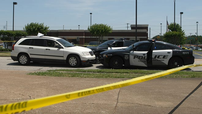 Jackson police cars at the scene where a woman shot herself on May 13.