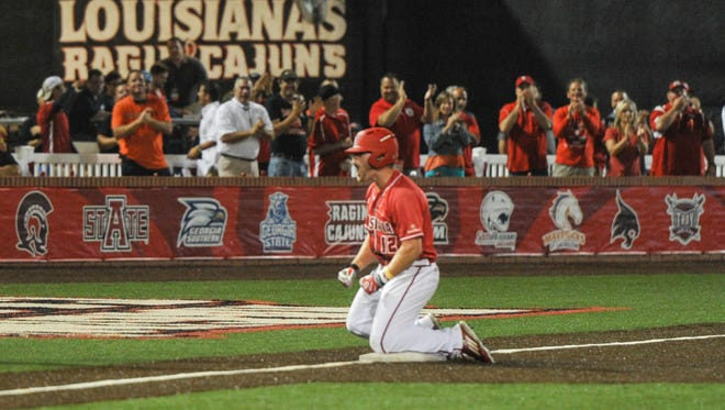 Joe Robbins slides into third while delivering the go-ahead RBI in the eighth inning of UL's 5-3 win over Prince in the NCAA Lafayette Regional at The Tigue.