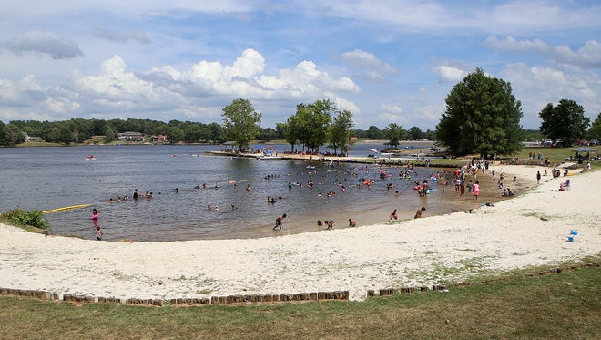 People enjoy the water at Beech Lake during the Festival of the Lakes in Lexington, Tenn., on Monday, July 4, 2016.